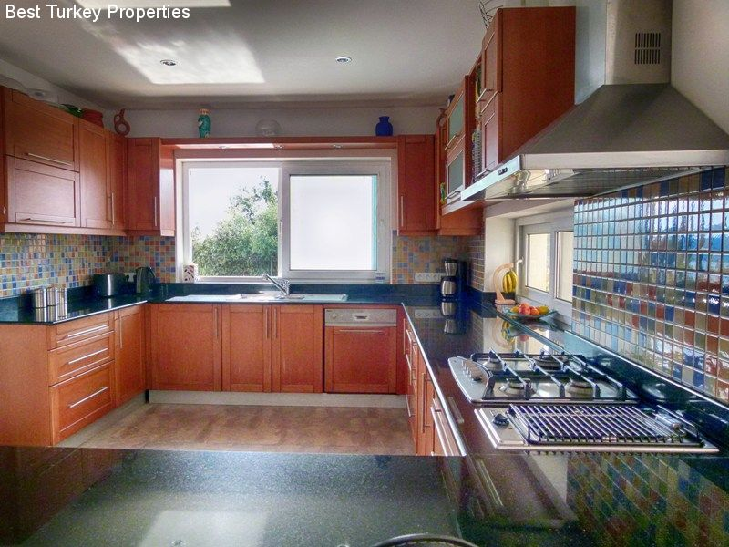 Well-equipped large Kitchen with sliding door to Kitchen Terrace giving onto Pool and Courtyard