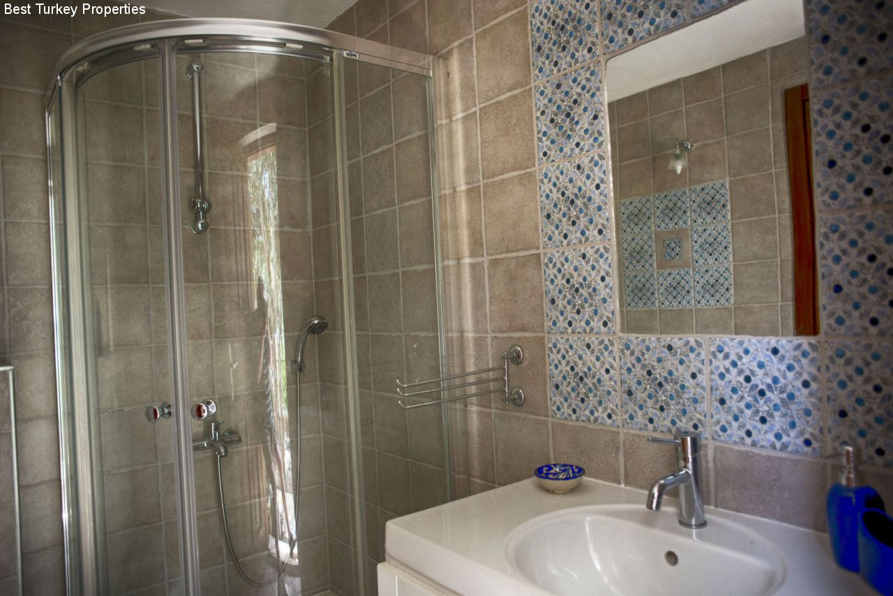 En-suite Bathroom (detail) belonging to Bedroom # with good-sized shower, WC & sink