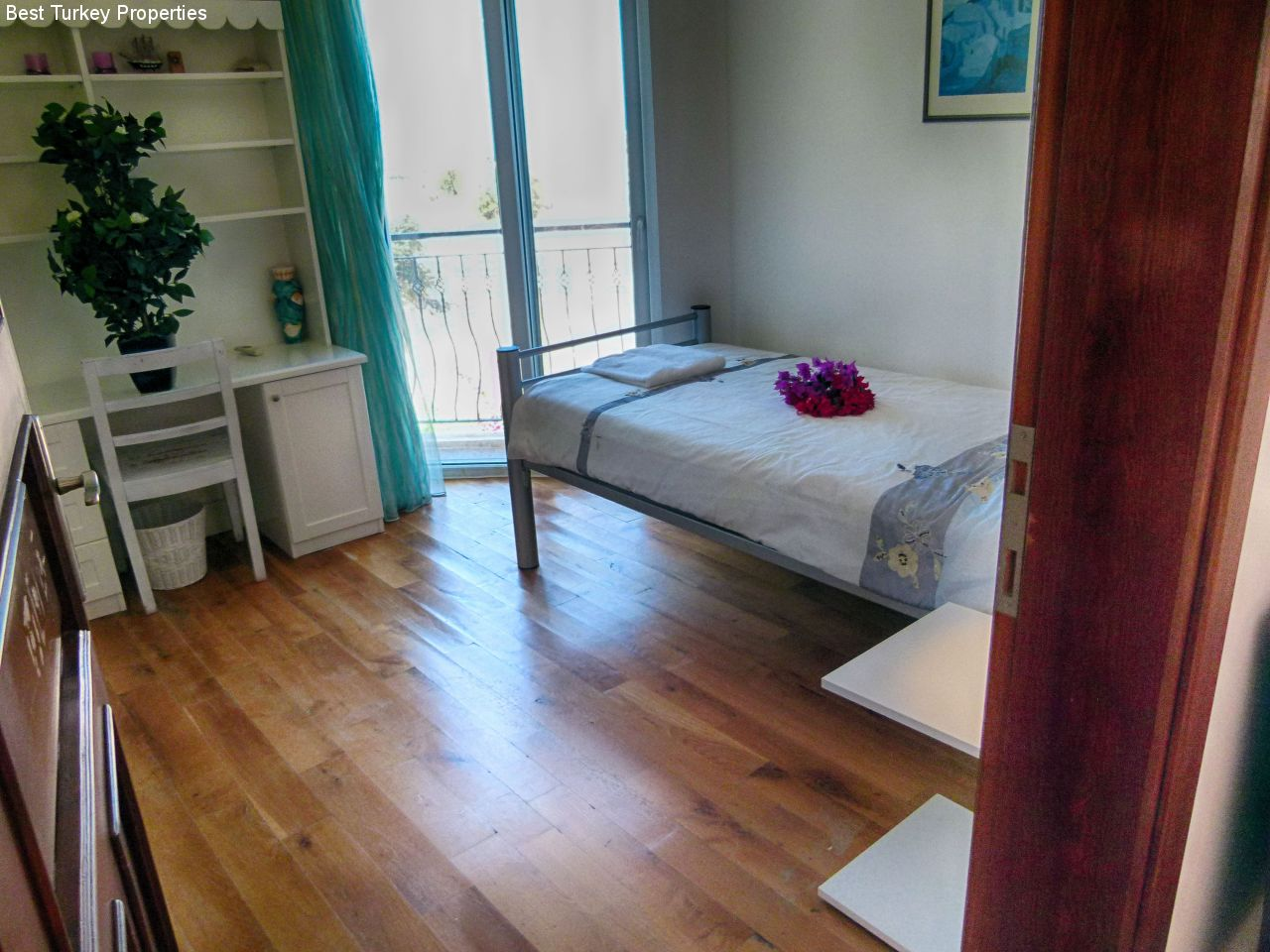 Bedroom # single room with comfortable bed and built-in wardrobes with Juliet Balcony looking west