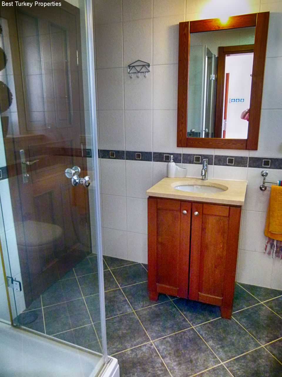Private Jack & Jill Shower Room shared by Beds # & # with large glass shower cubicle, sink &  WC