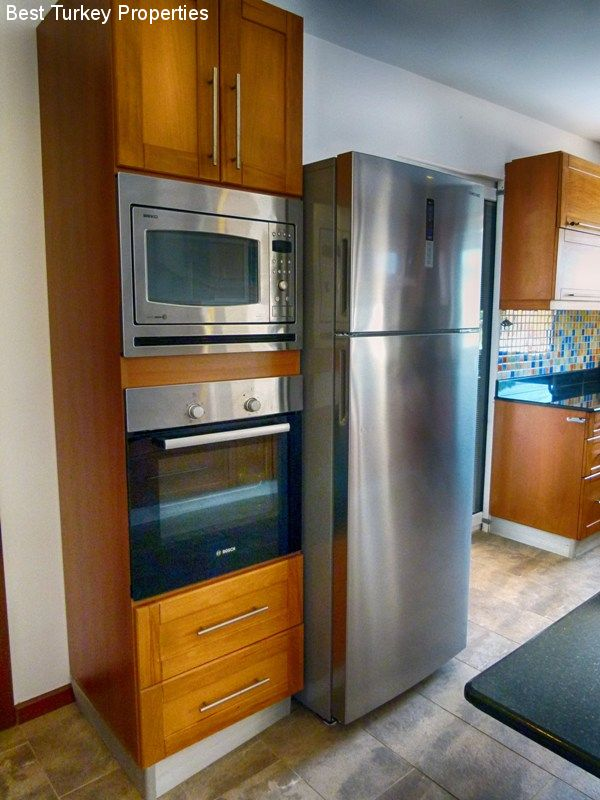 Large Fridge (freezer can be used as extra fridge space) and Double Oven with the upper oven being a Combi Microwave