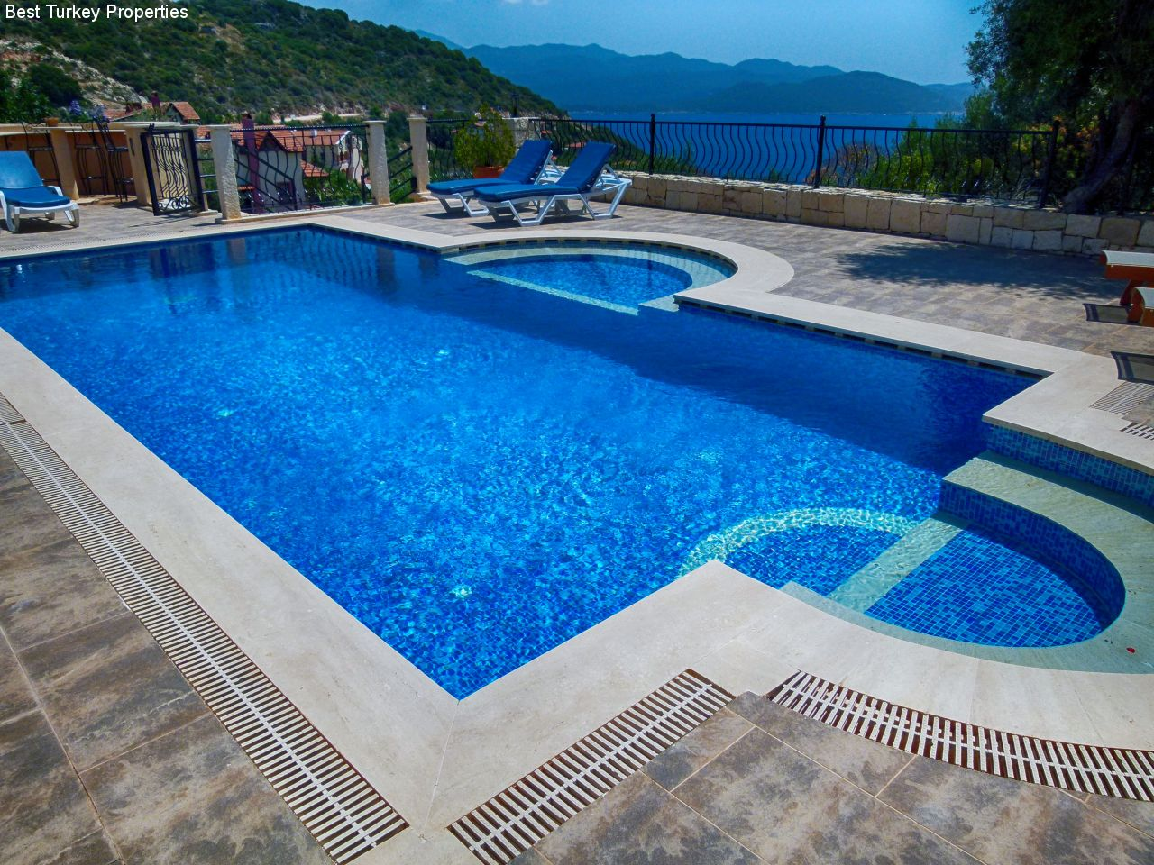 Generously proportione Pool with lots of terrace and great views