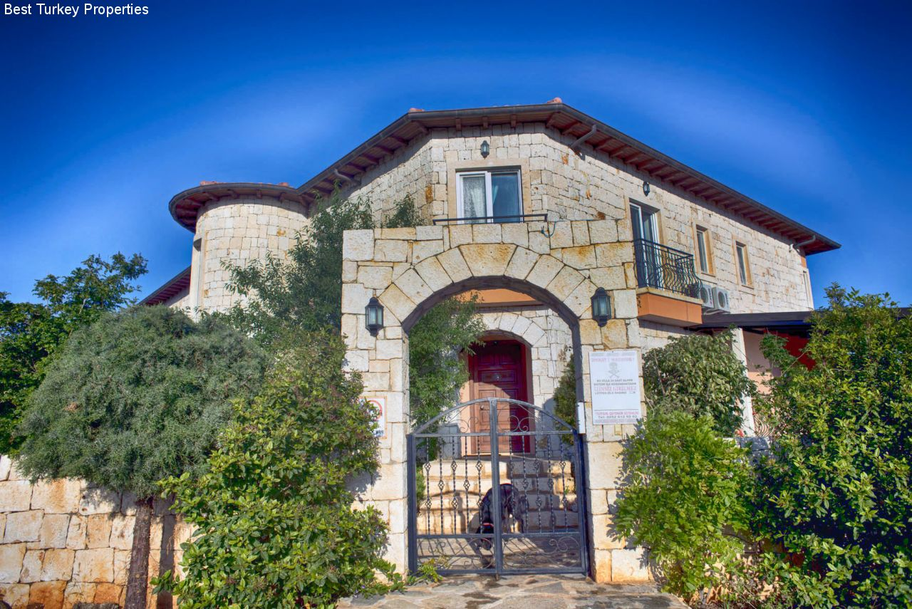 The Entrance from the road-side with extensive mature gardens all around the Property