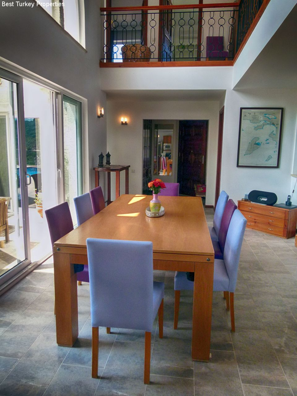 a The Dining Room towards the Entrance Vestibulewith French Window Doors onto the Courtyard