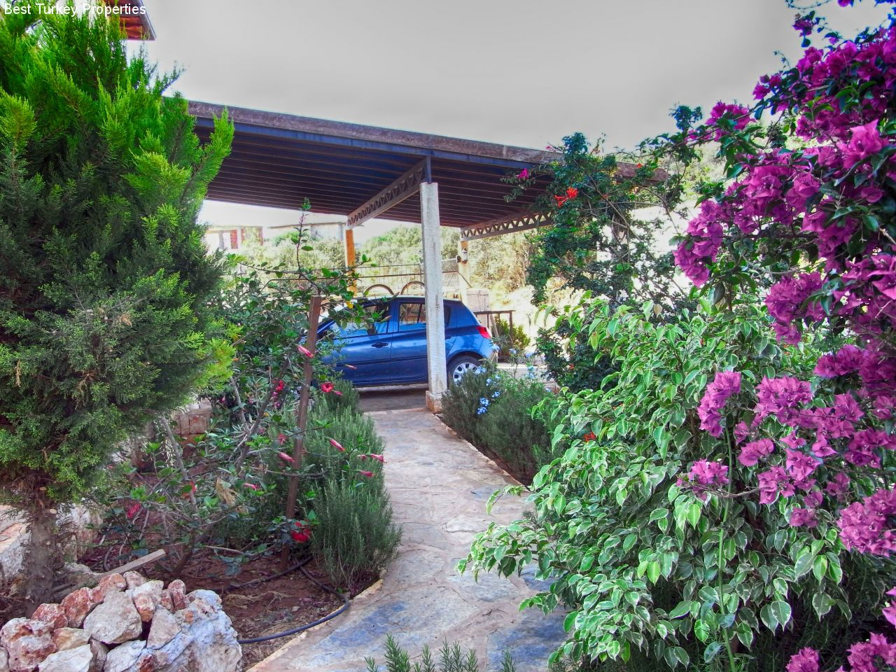 c The Gardens between the Entrance Gate and the -Car Port
